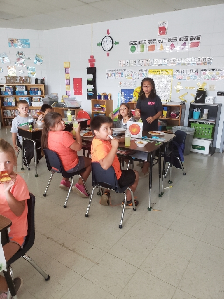 Second grade enjoying a pizza party for meeting our reading goal.